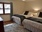 Main floor bedroom w/ 2 queen beds