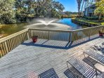 Pool's lower deck overlooks lagoon with fountain.