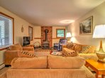 Relax on plush furnishings in the living room featuring a wood-burning stove.