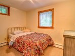 The third bedroom features a soft queen-sized bed.