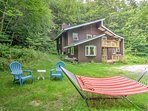 Relax by the fire pit in the 4 Adirondack chairs or hammock.