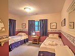 The second bedroom boasts 2 twin beds