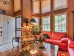 A towering 2-story wall of windows floods the main living space with natural light and warmth.