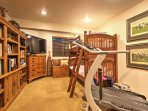 Work off some steam on the treadmill before crawling into the twin-over-twin bunk beds for a peaceful night of sleep.