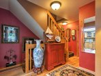 Head up the main staircase where the loft and master bedroom await.