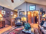 An oriental rug and mountain-themed decor add charm to the home's lovely loft.