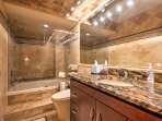 This en-suite master bath offers a jetted tub with shower, ideal for soaking your sore muscles after an adventurous day.