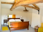 The bedroom with amazing oak beams and comfortable king sized bed
