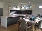 designer kitchen with large meals area