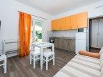 Orange Apartment - Lounge/dining/kitchen area