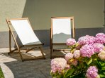 Orange Apartment - Sunny patio with sun longers