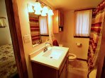 Full bathroom with tub/shower unit close to 2nd master bedroom.