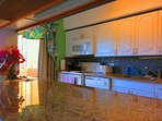 Granite counters and a breakfast bar with LAN internet