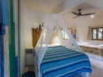 Bedroom #3 with queen bed + single. Balcony, jungle and pool views, ensuite.