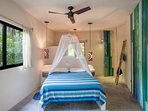 Bedroom #2 with queen bed, balcony, jungle + pool views, and ensuite with shower.