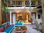 Casa Mandala with sliding glass doors open between the house and pool area.