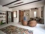 Casa Mandala living area with stylish furniture and artistic accents.