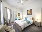 Large double bedroom with queen size bed and wardrobe