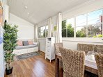 Sunroom and Dining Table.  Daybed opens up to queen size bed. TV with Netflix