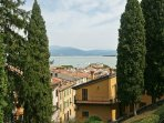 View over the houses on the lake from the castle through wonderful cypresses