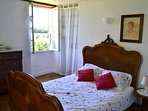 Double bedroom  with fantastic view over the valley. Ground floor. 140 cm bed