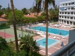 View of the pool and Tennis courts from your balcony. Lovely.