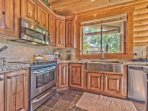 Fully Equipped Kitchen with Granite Countertops, Stainless Steel Appliances and Farm Sink