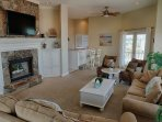 Wide screen TV above fireplace