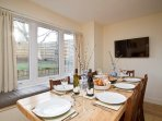 Dining area which has seating for ten and french doors leading to the garden