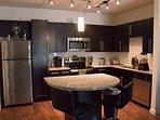 kitchen island, stainless steel, granite.