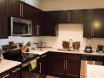 flat cooktop, appliances: Blender, Dual sided waffle maker, Apple cutting boards, 4 toaster, kettle!