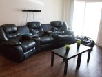 100% Leather recliner couch, Sound bar, coffee table, Leather bean bag!