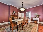 Enjoy dinners in the dining room where natural light highlights the antique fireplace and  6-person dining table.