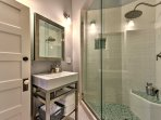 Clean off in the pristine master bathroom with a luxurious walk-in shower and single vanity.