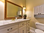 The second bathroom features a large vanity and walk-in shower.