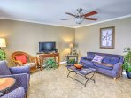 Relax on the vibrantly colored couches in the living area and watch a movie on the flat-screen Smart cable TV.