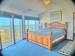 Master bedroom with king bed and panoramic view