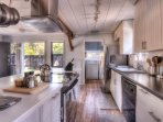 Stainless steel appliances throughout the kitchen