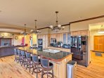 The fully equipped kitchen features 2 stoves, an expansive island with 6 stools and more!