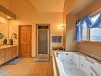 The en-suite master bathroom features a Jacuzzi tub and separate shower.