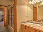 The two downstairs bedrooms share a Jack-and-Jill bathroom with separate sinks.