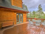 Look out to towering pine and aspen trees from the expansive deck.