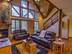 Relax on the leather couch in the living room during your stay at this 4-bedroom, 4-bathroom vacation rental cabin in...