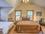 Head upstairs, where you'll find a king bed and a queen bed in the third bedroom.