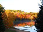 Incredible October fall colors viewed from the patio of Sandys lake house