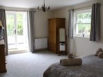 Large Master Bedroom - patio doors to terraced & balcony for far reaching views