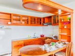 Well equipped modern kitchenette and dining area