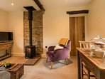 Cosy lounge with wood burning stove and comfy sofas