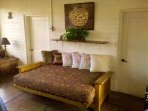 Queen futon in red rock breezeway room for extra person to sleep on