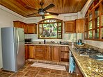 Well appointed kitchen with granite countertops, gas cooktop, refrigerator, dishwasher & microwave.